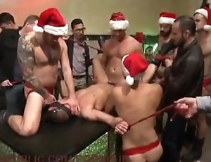 Muscular Christmas whore is bound in public