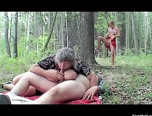 Busty granny having enjoyment in the forest